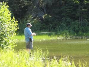 Fishing a small lake on a beautiful day.
