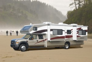 This is possibly our dream motorhome, Host 330.  4x4 diesel, winter insulated, 4 slides, etc..