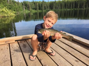 Wyatt holding a beautiful rainbow trout at South Rolly Lake.