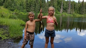 The kids proudly holding their catch!